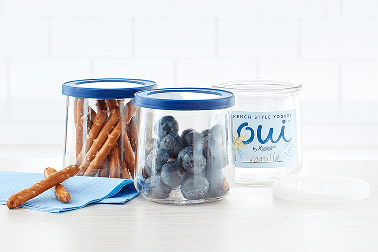 two Oui glass pots repurposed to hold blueberries and pretzel sticks